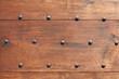 Wooden door with nails texture background