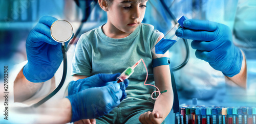 children health care concept Checkup pediatrician / pediatric medical diagnostic concept. Around child patient is the hand of a doctor with a stethoscope, two hands performing a blood test and a hand