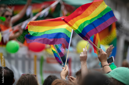 Pinturas sobre lienzo  People wave LGBTQ gay pride flags at a solidarity march