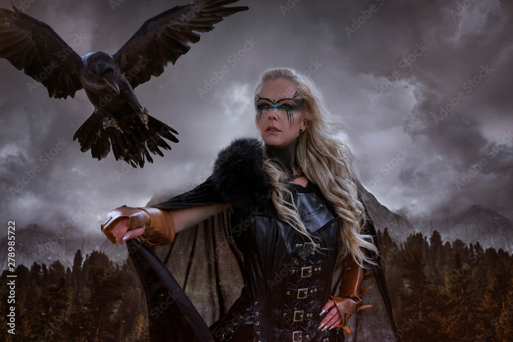 Photo  landscape of Norwegian fjords, Viking blonde with war shield, sword and a black