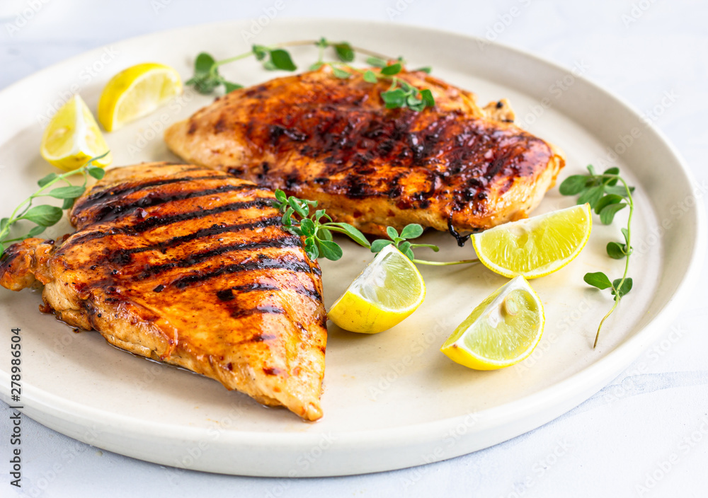 Fototapety, obrazy: Healthy Grilled Chicken Breast with Fresh Herb and Lemon  Directly Above Photo. Cooked Chicken Breast in a White Plate .and on White Background.