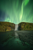 View of Northern Lights over Skogafoss waterfall