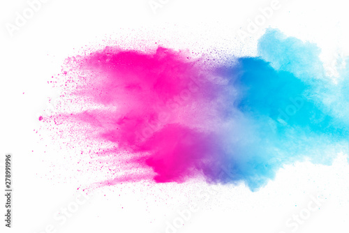 Foto auf AluDibond Formen Explosion of multicolored dust on white background.