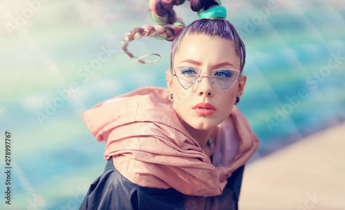 Vászonkép The avant-garde portrait girl with unusual make up and fancy sun glass