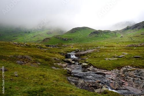 Photo  Tiberthwaithe Beck running though the moorland