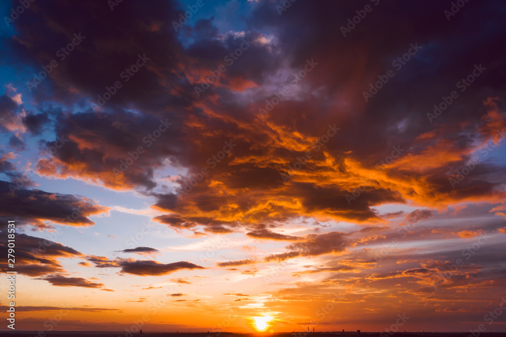 Fototapety, obrazy: Dramatic orange sky with clouds at sunset