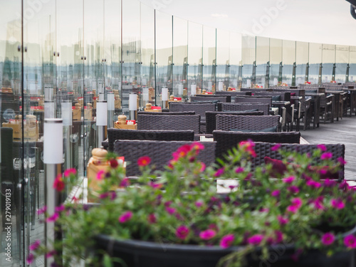 Sky cafe on the roof terrace with view of modern city Canvas Print