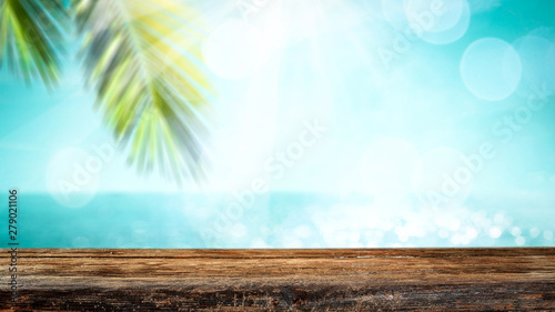 Foto auf AluDibond Licht blau Table background with the beautiful ocean and beach view. Palm leaves frame. Blank space for a product.