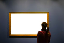 Woman In Gallery Room Looking At Empty Picture Frame - Mock Up Art Concept.
