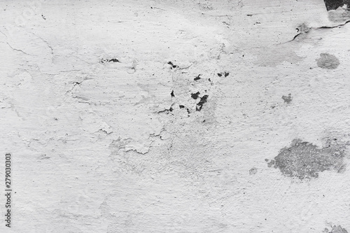 Fotografia  Texture of a concrete wall with cracked paint