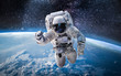 canvas print picture - Astronaut in the outer space over the planet Earth. Abstract wallpaper. Spaceman. Elements of this image furnished by NASA