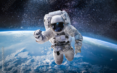 Astronaut in the outer space over the planet Earth. Abstract wallpaper. Spaceman. Elements of this image furnished by NASA