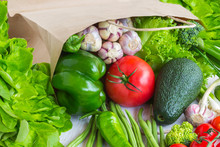 Healthy Food In Paper Bag Of Different  Vegetables On White Background. Top View.