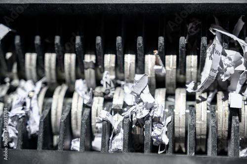 Foto op Canvas Begraafplaats closeup view of office paper shredder teeth