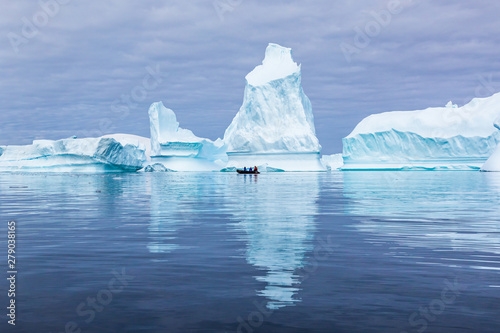 Ingelijste posters Antarctica Iceberg graveyard in Antarctica with many huge mass of ice stranded offering spectacular polar landscape for tourists on zodiac boats, frozen continent, Antarctic Peninsula