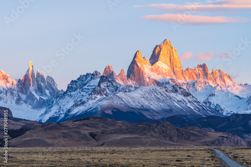 Türaufkleber Himmelblau Beautiful dawn golden orange light of sun rise over the Fitz Roy and Cerro Torre peak snow mountain in the morning beside the route 40 road from El Calafate to El Chalten, south Patagonia, Argentina