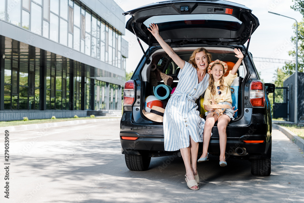 Fototapety, obrazy: happy mother and daughter with outstretched hands near car