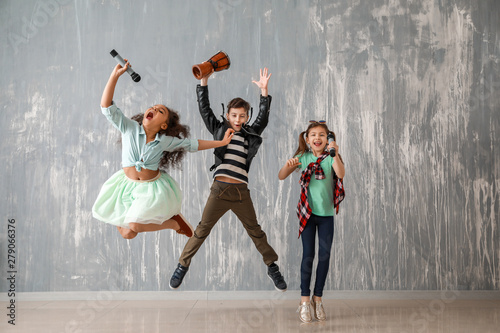 Band of little musicians against grunge wall - 279066376
