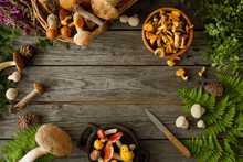 Mushrooms On Old Wooden Background. Card On Autumn Or Summertime. Forest Harvest. Boletus, Chanterelles, Leaves, Berries. Flat Lay.