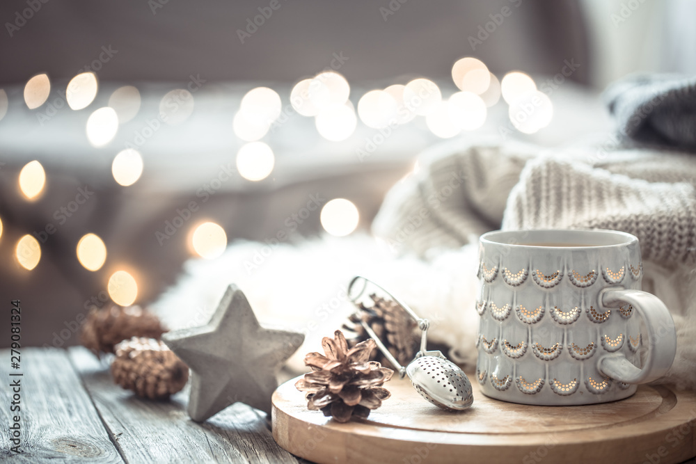 Fototapety, obrazy: Coffee cup over Christmas lights bokeh in home on wooden table with sweater on a background and decorations. Holiday decoration, magic Christmas