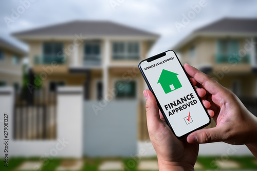 finance loan agreement and house key Mortgage Loan approval on mobile phone in a Canvas Print