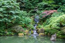 Inside A Peaceful Japanese Garden, A Japanese Pagoda Rock Statue In Portland