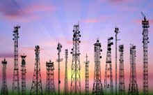 Fifteen Antenna Tower Silhouettes On Sunset Background