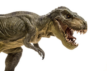 An extreme closeup view of an ominous T-Rex dinosaur figurine isolated against a clean white background. Monstrous animal with sharp teeth.