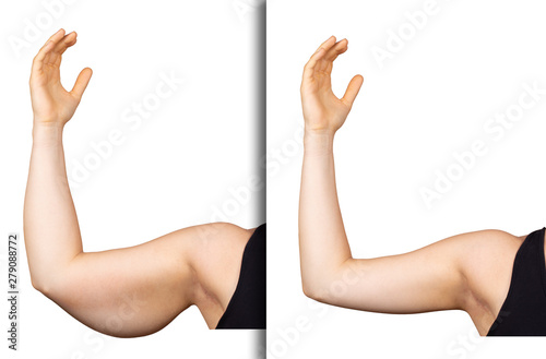 Obraz na plátne  A young Caucasian woman holds her arm in the air, isolated against a clean white background