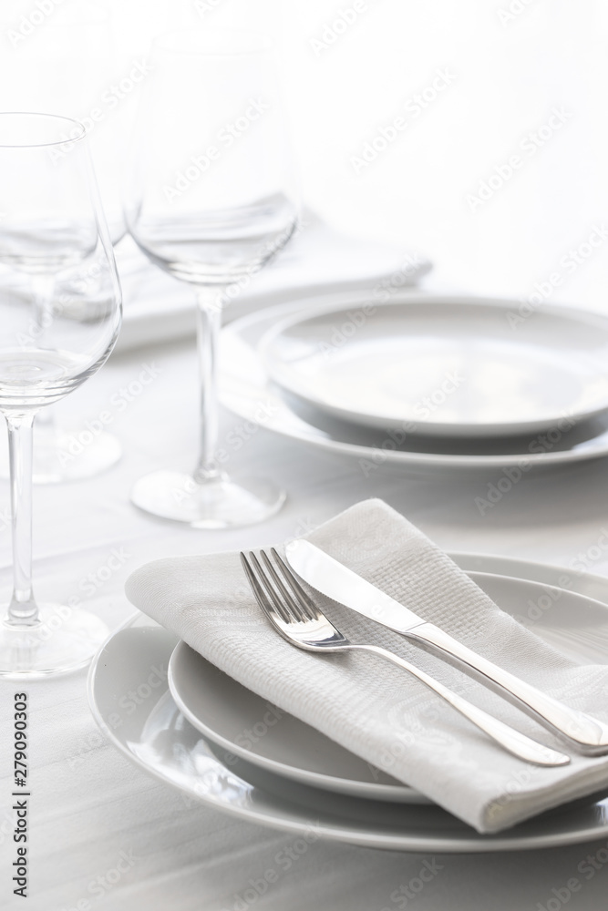 Fototapety, obrazy: Table setting white and grey colour. Empty glasses and plates set with napkin and cutlery. Restaurant interior background...