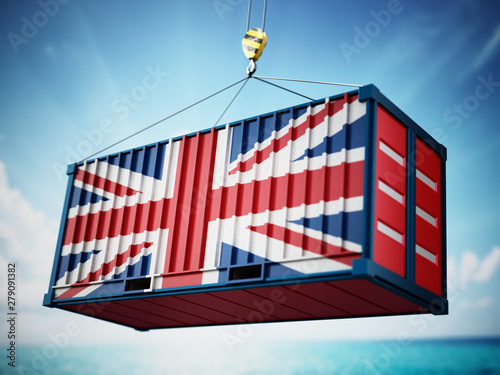 Foto Cargo container with flag of Britain against blue sky