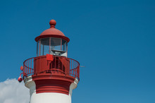 View Of Red Lighthouse On Clou...