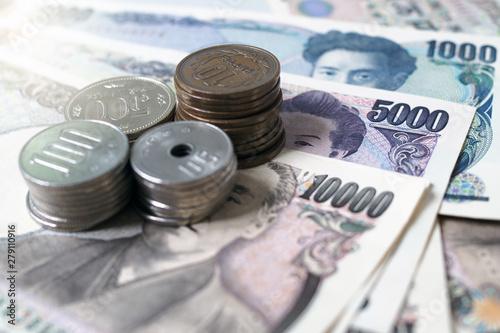 Fotografie, Obraz  Japanese yen notes and Japanese yen coins for money concept background