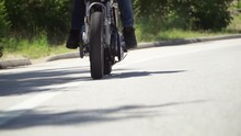 Slow Motion Close Up Of Motorcycle Wheel While Riding