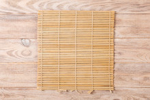 Empty Asian Food Background. Brown Bamboo Mat On Wooden Background Top View With Copy Space Flat Lay