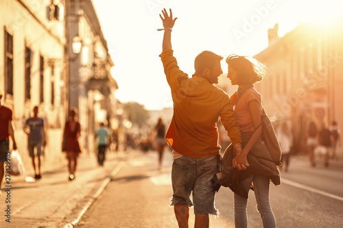 Fotografie, Obraz  Young couple holding hands while going to a music festival
