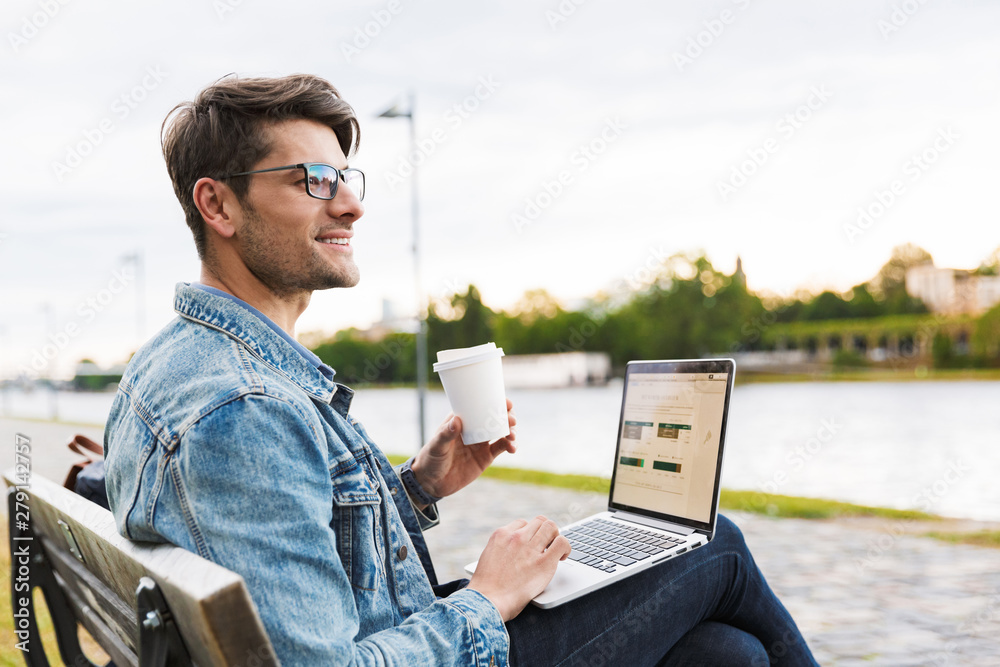 Fototapety, obrazy: Handsome young man dressed casually spending time outdoors