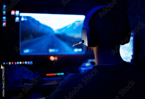 Shot of the Beautiful Pro Gamer Girl Playing in First-Person Shooter Online Video Game on Her Personal Computer Canvas Print
