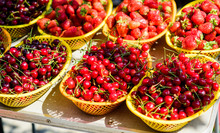 Vitamin And Dieting. Seasonal Fruit. Natural Shopping. Organic Useful Food. Healthy Lifestyle. Farm Market. Summer Berry Market. Ripe Cherries Cherry. Red Strawberry In Basket. Berry Background
