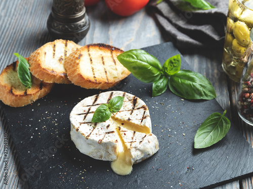 Fototapeta Camembert cheese grill ,on black stone background obraz