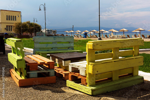 Multicolored table and benches from the pallets on Corinth street, Peloponnese, Canvas-taulu