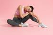 Leinwanddruck Bild - Fitness woman model in fashion sportswear on pink background