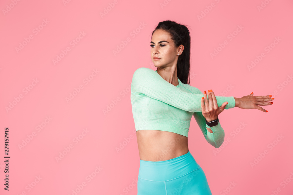 Fototapety, obrazy: Sports fitness woman isolated over pink wall background make stretching exercises.