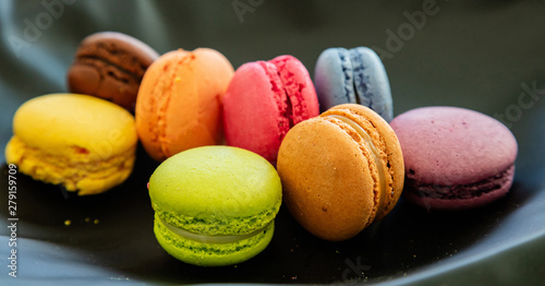 Foto op Canvas Macarons Colorful macarons on black background, close up view
