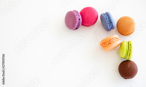 Fotografía Colorful macarons on white background, close up view