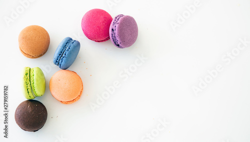 Foto auf Gartenposter Macarons Colorful macarons on white background, close up view