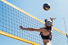 Girl Playing Beach Volleyball. Beach Volley Ball Match. Outdoor Sports Activities, Vacation Fun Time.