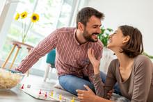 Couple Having Fun Playing Ludo Board Game