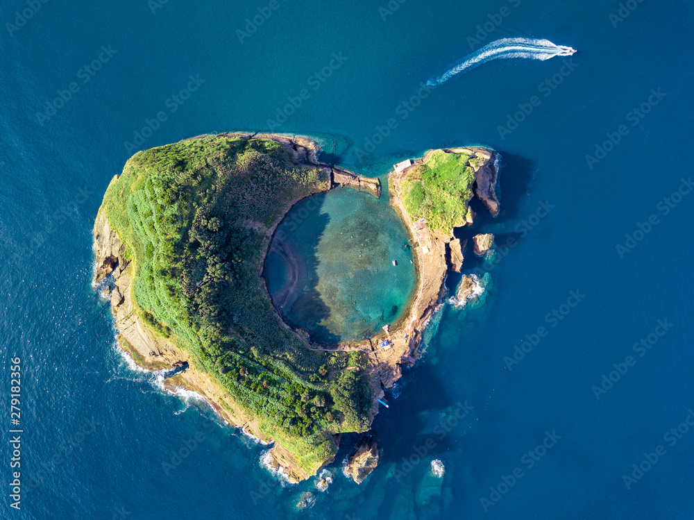 Fototapety, obrazy: Azores aerial panoramic view. Top view of Islet of Vila Franca do Campo. Crater of an old underwater volcano. San Miguel island, Azores, Portugal. Heart carved by nature. Bird eye view.