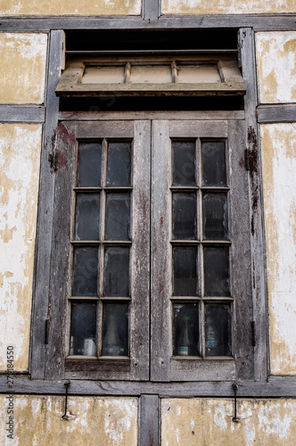 Photo Window with the wooden carved architrave